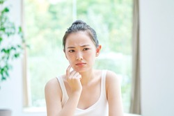 beauty image, Asian woman having the skin trouble