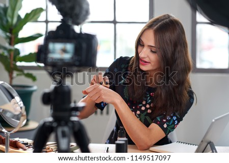 Beauty influencer recording content for online vlog, modern occupation profession job #1149517097