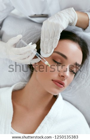 Beauty Injections. Woman Getting Face Lifting Procedure Closeup #1250135383