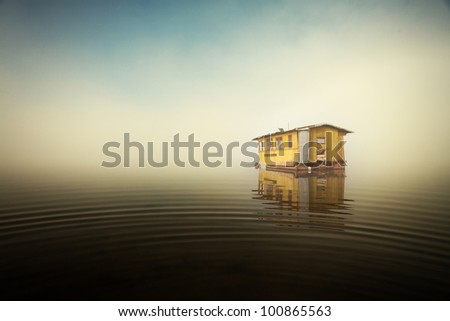 beauty lake,fog and yellow cottage
