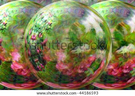 Beauty lies in the garden looking glass.  Three orbs distort yet do not block the beauty of the flower garden in all its iredescent beauty.