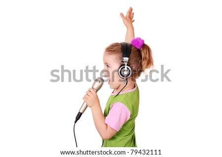 beauty little girl hold microphone and singing