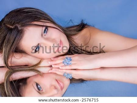 beauty lying on a blue mirror