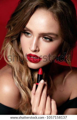 Stock Photo Beauty Makeup. Woman With Red Lips And Beautiful Face On Red Background. High Resolution.