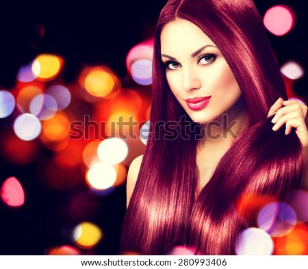 Beauty Model girl with Healthy Brown Hair. Beautiful brunette woman touching her long smooth shiny straight hair. Hairstyle. Hair cosmetics, haircare. Hair care, extensions