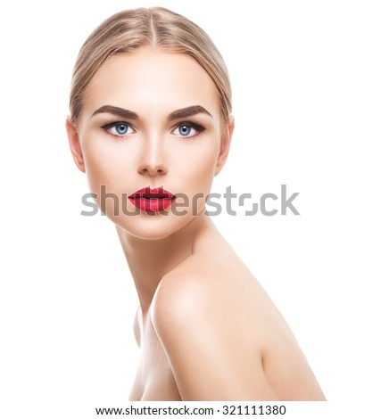 Beauty model girl with perfect make-up looking at camera isolated over white. Portrait of attractive young woman with blond hair on white background. Beautiful female face with clear fresh skin