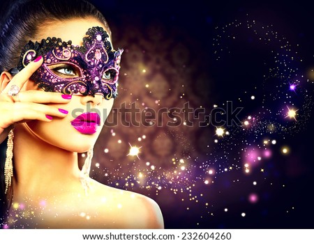 Beauty model woman wearing venetian masquerade carnival mask at party over holiday dark background with magic stars. Christmas and New Year celebration. Glamour lady