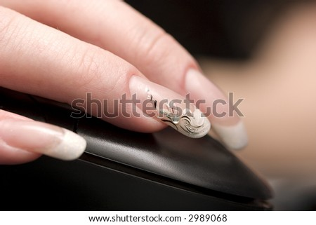 Beauty nails, fingers over computer mouse. Close-Up shot