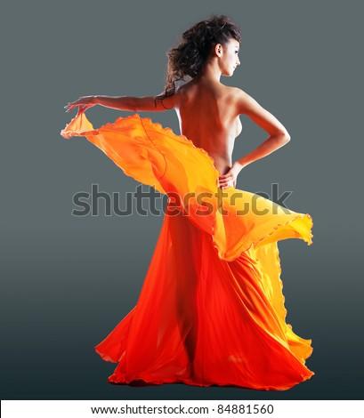 beauty naked woman dance in orange veil