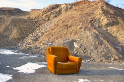 Beauty of decay - old grunge armchair with a great mountain view of Rtanj mountain in Eastern Serbia