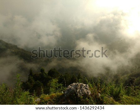 Beauty of nature with perfect balance of Mountain, fog and cloud.