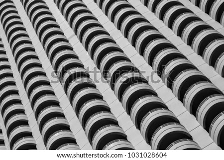 beauty of repetition shape conceptual art, terrace of skyscraper building in closeup black and white   #1031028604