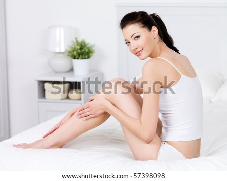 Beauty of young pretty woman with perfect shape and clean fresh beatiful legs - indoors