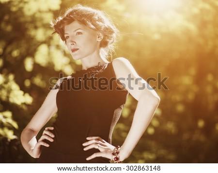 Beauty outdoor female portrait. Seasonal backgrounds