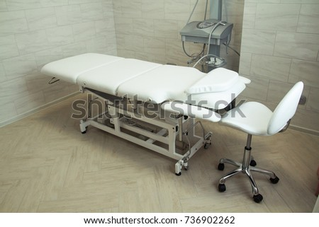 beauty parlor with a couch and equipment for face #736902262