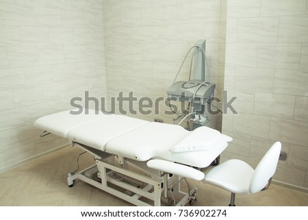 beauty parlor with a couch and equipment for face #736902274