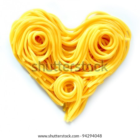 Beauty Pasta Heart. Heart-shaped arrangement of pasta, or spaghetti, isolated on white, concepetual of love and romance.