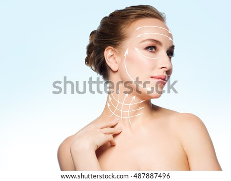 beauty, people, plastic surgery, anti-age and health concept - beautiful young woman touching her neck over blue background #487887496