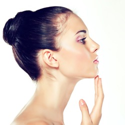 Beauty Portrait. Beautiful Spa Woman Touching her Face .  Cosmetics and cosmetology. Clean face , skin care . profile face girl