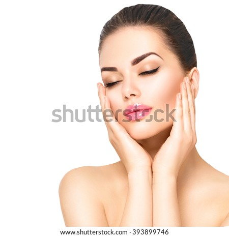 Beauty Portrait. Beautiful Spa Woman Touching her Face. Perfect Fresh Skin. Beauty brunette Model. Youth and Skin Care Concept. Studio shot. Isolated on white background #393899746