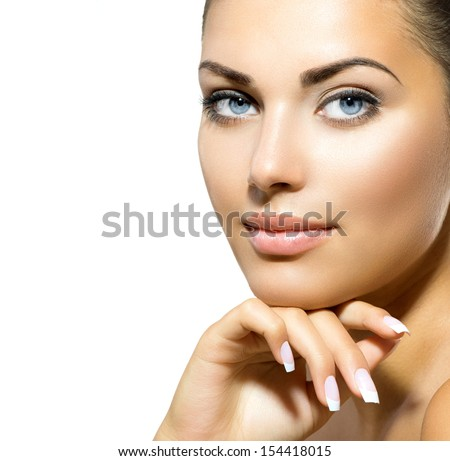 Beauty Portrait. Beautiful Spa Woman Touching her Face. Perfect Fresh Skin closeup. Isolated on White Background. Pure Beauty Model. Youth and Skin Care Concept