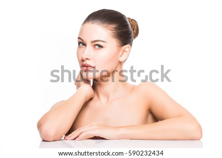 Beauty Portrait. Beautiful Spa Woman Touching her Face. Perfect Fresh Skin. Isolated on White Background. Pure Beauty Model. Youth and Skin Care Concept #590232434