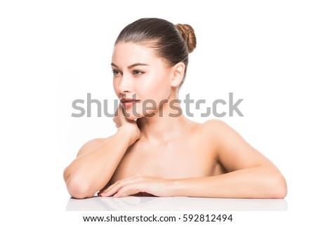 Beauty Portrait. Beautiful Spa Woman Touching her Face. Perfect Fresh Skin. Isolated on White Background. Pure Beauty Model. Youth and Skin Care Concept #592812494