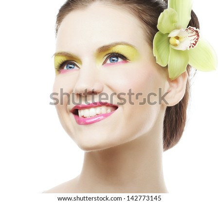 Beauty Portrait. Beautiful stylish girl with orchid flower in hair.