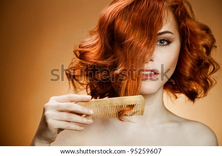 Beauty Portrait. Curly Hair and Comb