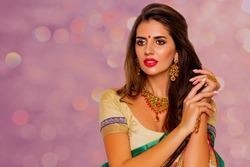 Beauty Portrait indian girl.  Jewelry. Young Hindu woman model with kundan jewelry set. Red lips. Close up. Traditional India  costume  lehenga choli or sari. make-up