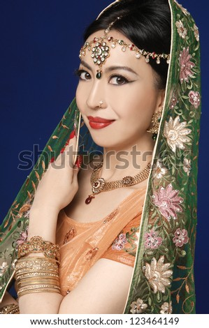 Beauty portrait of a asian woman in traditional clothes with bridal makeup and jewelry, closeup shot