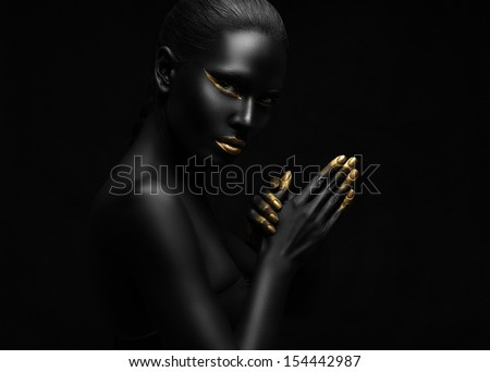 beauty portrait of a beautiful black woman with gold elements