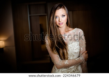 Beauty portrait of a beautiful spa woman in hotel room. Perfect fresh skin. Pure beauty model girl. Youth and skin care concept. Gorgeous bride to be before the wedding