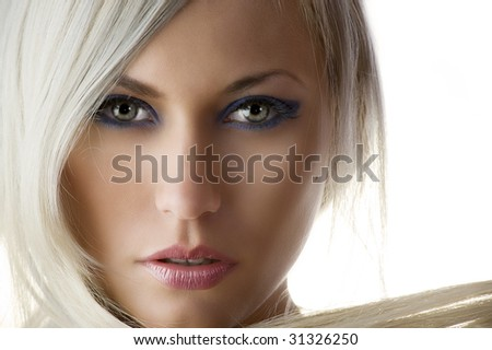beauty portrait of a cute blond girl with long hair and skin like a dolly