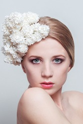 BEAUTY portrait of a girl with flowers in her hair. Girl with the white  lilac flowers. Fresh Clean Skin.