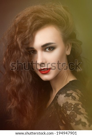 Beauty Portrait of a girl with red lipstick and fluffy hair