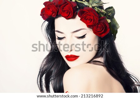 Stock Photo beauty portrait of a gorgeous woman with wreath of red roses on her head, studio white