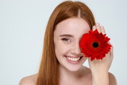 Beauty portrait of a happy woman with flower isolated on a white background