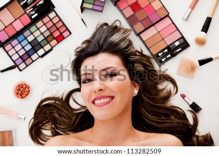 Beauty portrait of a woman lying on the floor with makeup
