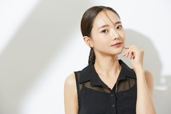 Beauty portrait of a young Asian woman in a black dress