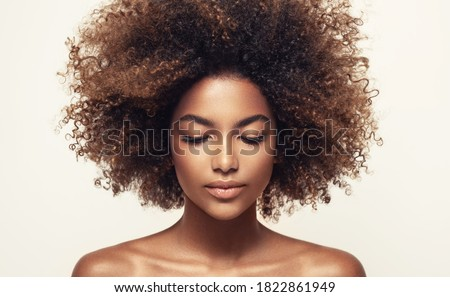 Beauty portrait of african american black  woman with clean healthy skin .Life style and cosmetic. Beautiful afro girl.Curly  hair