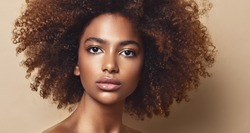 Beauty portrait of african american girl with clean healthy skin   Beautiful and serious black woman.Curly afro hair