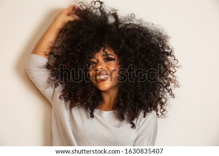 Beauty portrait of african american woman with afro hairstyle and glamour makeup. Brazilian woman. Mixed race. Curly hair. Hair style. White background. Photo stock ©