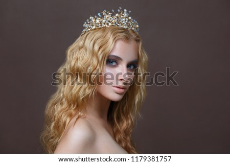 Beauty portrait of an elegant girl with a bouquet in the crown.
