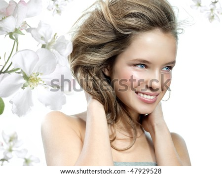 beauty portrait of attractive young caucasian  smiling woman isolated on white background, studio shot. Happy, toothy smile, face, skin, hear, head and shoulders, flowers - stock photo