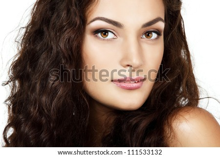 Beauty portrait of beautiful cheerful young fresh woman with long brown healthy curly hair. Isolated on white background