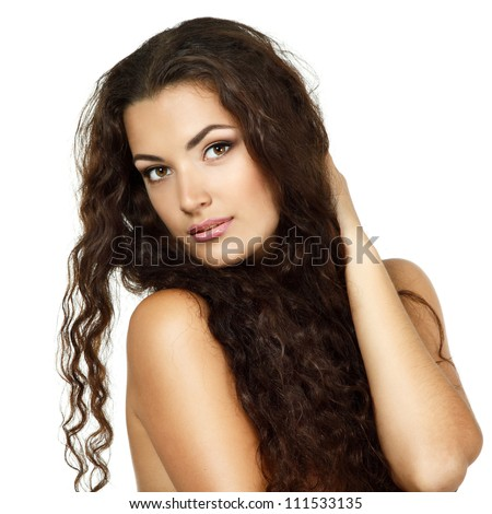 Beauty portrait of beautiful cheerful young fresh woman with long brown healthy curly hair. Isolated on white background - stock photo