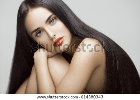 Shutterstock Beauty portrait of beautiful young model girl with long straight hair. Professional makeup.