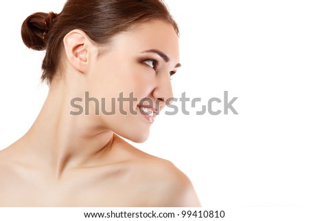 Beauty portrait of beautiful young woman face in profile. Isolated on white background