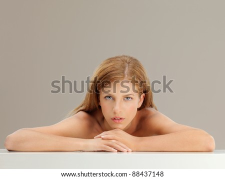 beauty portrait of blonde woman looking at camera